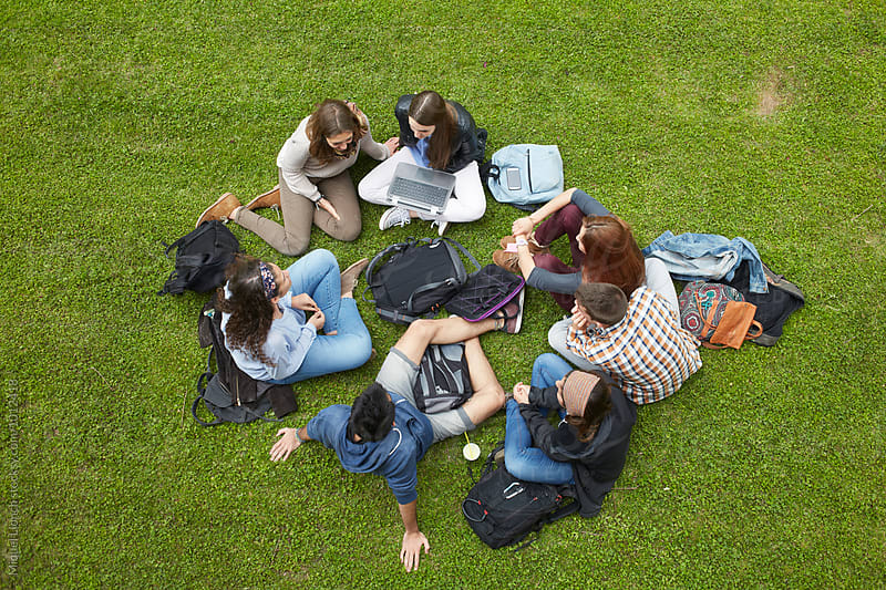 Group of students sitting on the grass from above by Miquel Llonch for Stocksy United