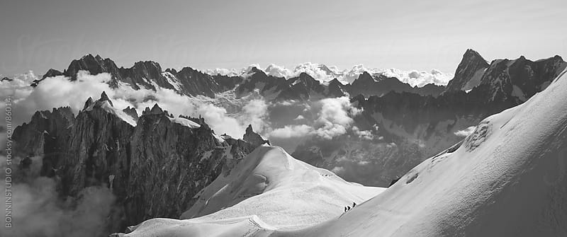 Panorama of three aplinists climbing to montblanc. Beautiful Landscape, France. by BONNINSTUDIO for Stocksy United