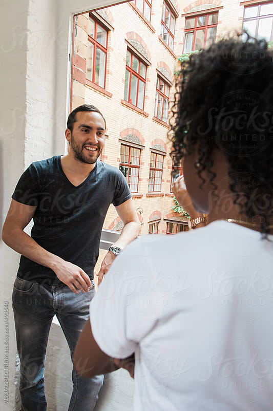 Male Caucasian Talking to Female African During Coffee Break at Work by VISUALSPECTRUM for Stocksy United