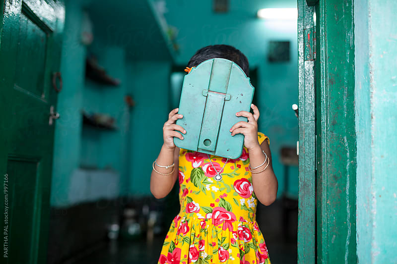 a girl covered her face with mirror by PARTHA PAL for Stocksy United