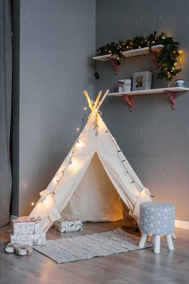 Gifts near tent with fairy lights & Gifts Near Tent With Fairy Lights | Stocksy United