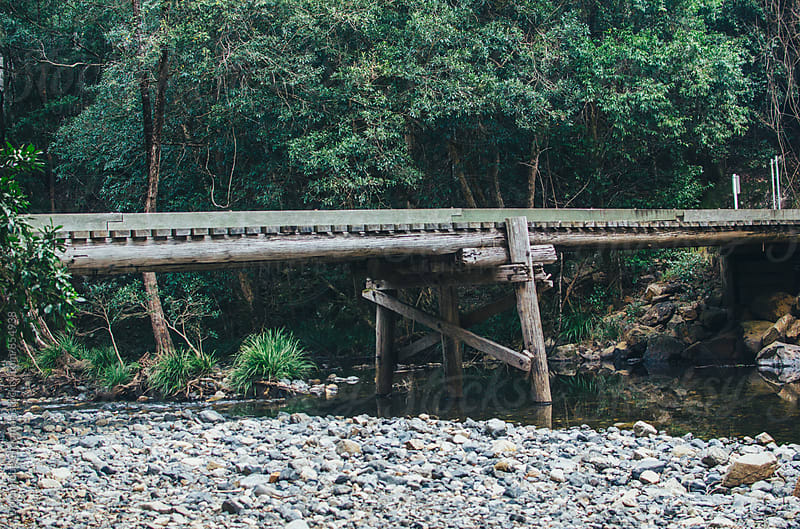 Wooden bridge over creek by Dominique Chapman for Stocksy United