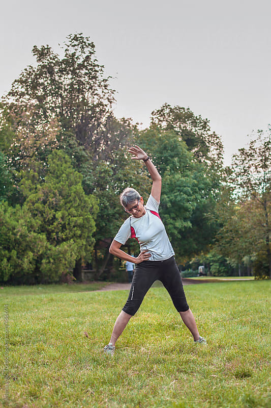 Senior woman exercise in the park by Jelena Jojic Tomic for Stocksy United