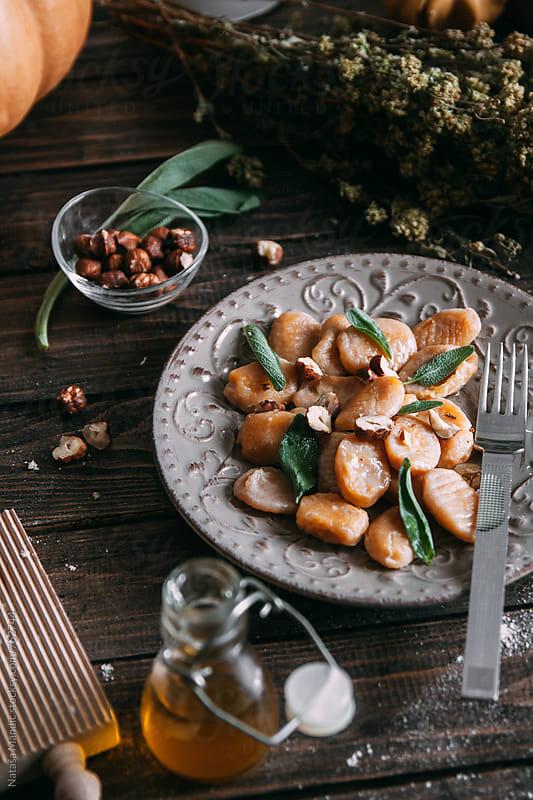 Homemade pumpkin gnocchi with sage and roasted hazelnuts by Nataša Mandić for Stocksy United