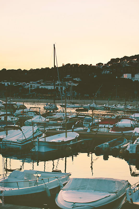 Boats on costa brava landscape. Pier of Llafranc, Catalunya. by BONNINSTUDIO for Stocksy United