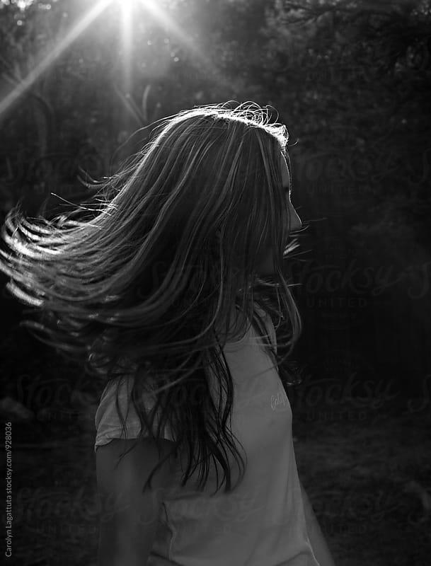 Teenage girl with long hair flying by Carolyn Lagattuta for Stocksy United