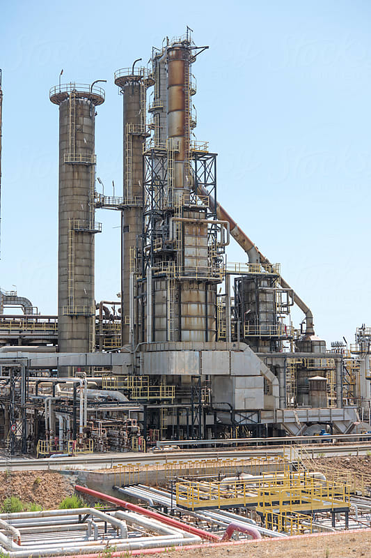 Oil and gas refinery, pipelines and towers, heavy industry by Luca Pierro for Stocksy United
