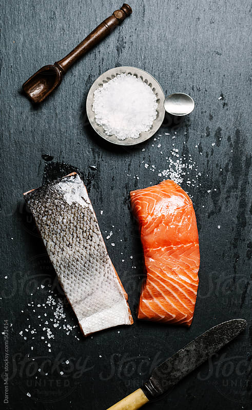Raw salmon fillets on slate background. by Darren Muir for Stocksy United