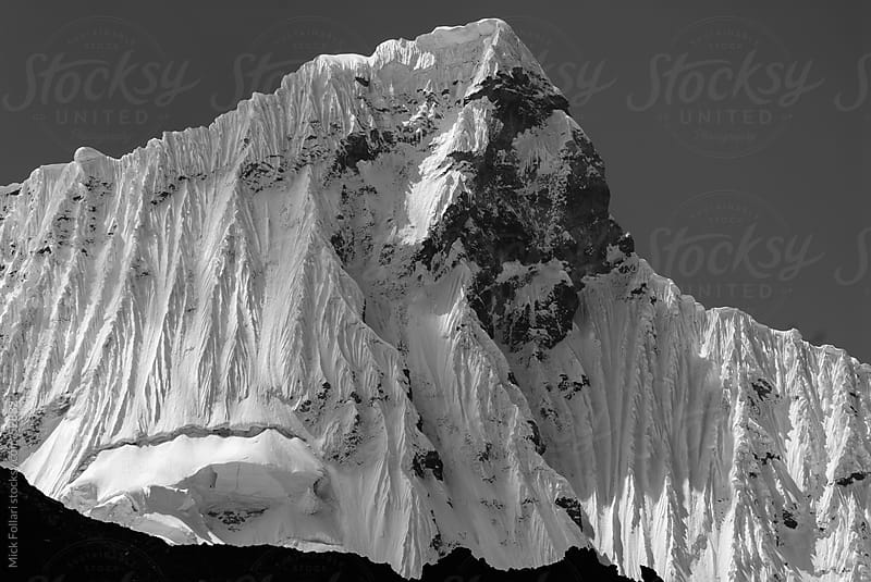 Dramatic high altitude peak in Black & White. by Mick Follari for Stocksy United