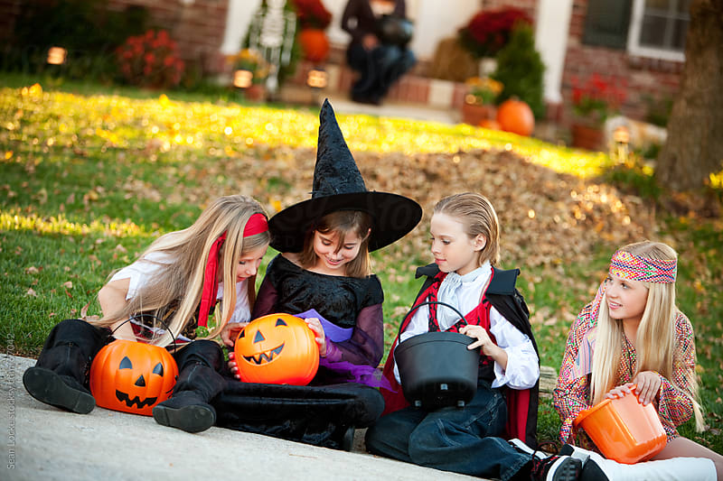 Halloween: Children Look at the Candy They Received by Sean Locke for Stocksy United