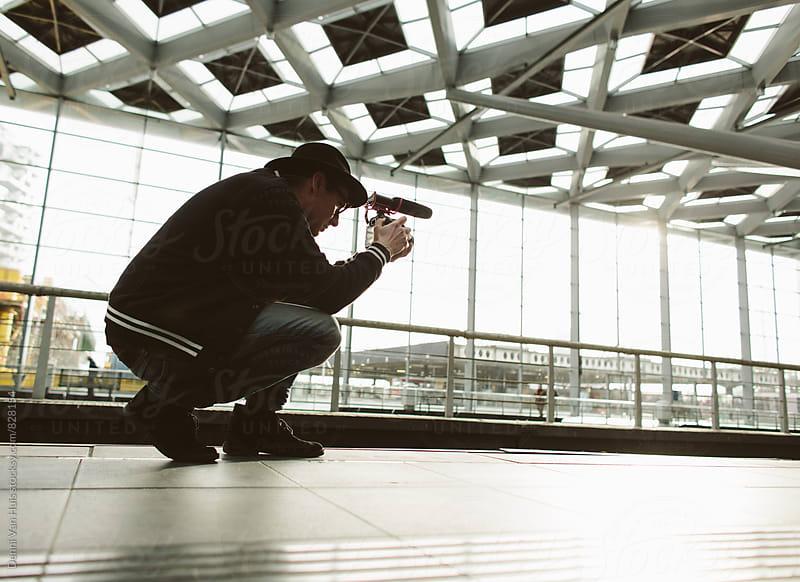 Creative man filming by Denni Van Huis for Stocksy United