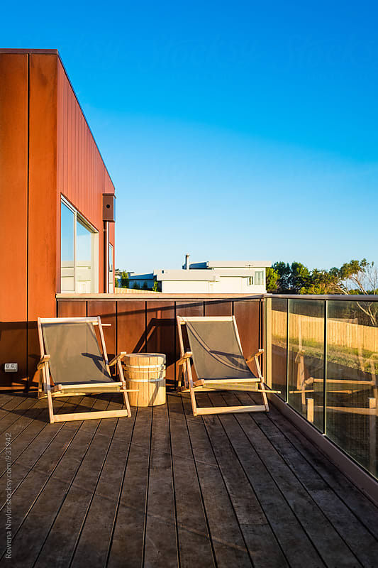 Raised sun deck of luxury home by Rowena Naylor for Stocksy United