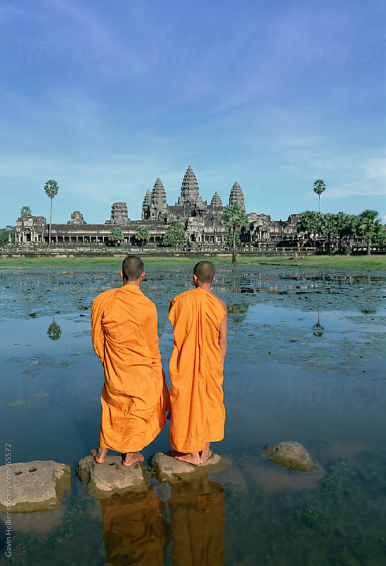 Buddhist monks standing in front of Angkor Wat, Angkor, Siem Reap, Cambodia, Indochina, Asia by Gavin Hellier for Stocksy United