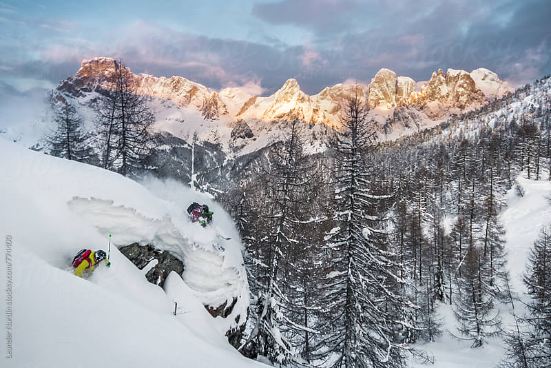 2 freerider skiing in snowcovered forest by Leander Nardin for Stocksy United