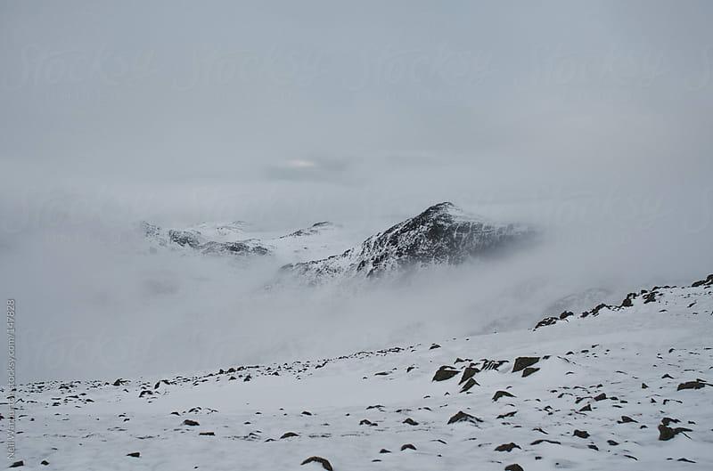 Mountain Peak in the Cloud by Neil Warburton for Stocksy United