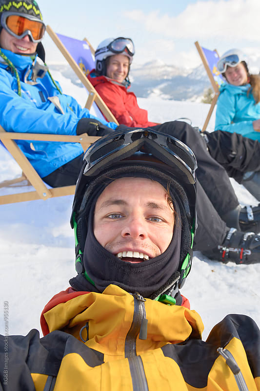 Friends taking a selfie on the ski slope by RG&B Images for Stocksy United