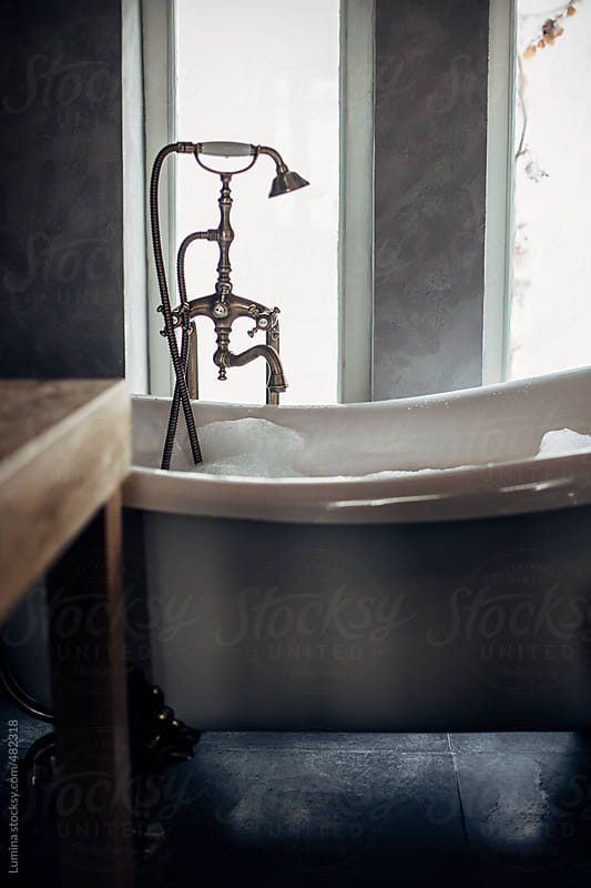 Bubble Bath in a Retro Tub by Lumina for Stocksy United