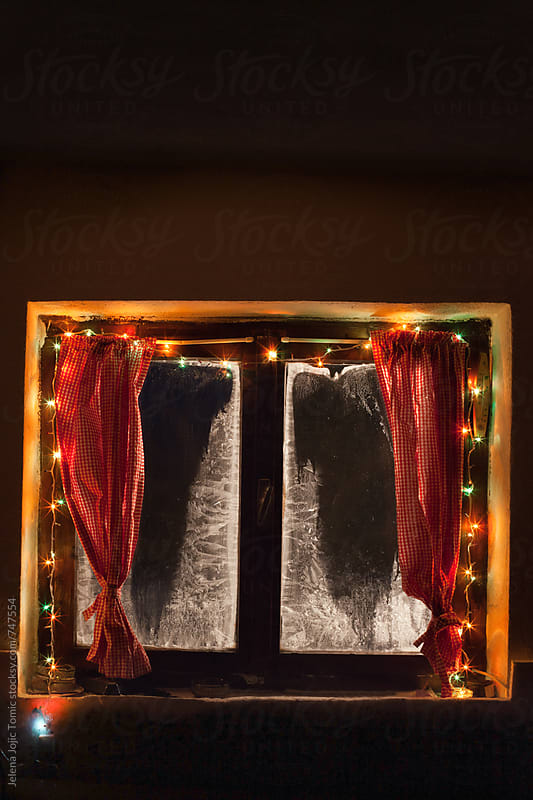Christmas decorations on a cold winter night by Jelena Jojic Tomic for Stocksy United