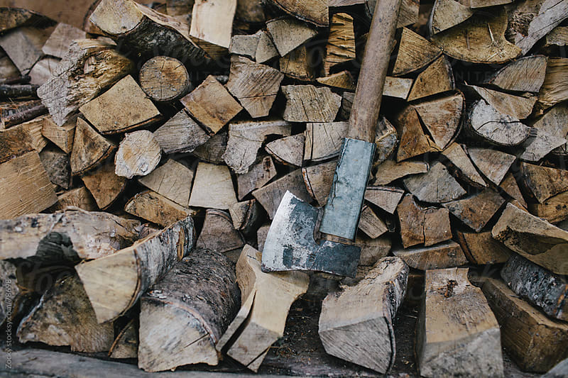 Axe and firewood by Zocky for Stocksy United