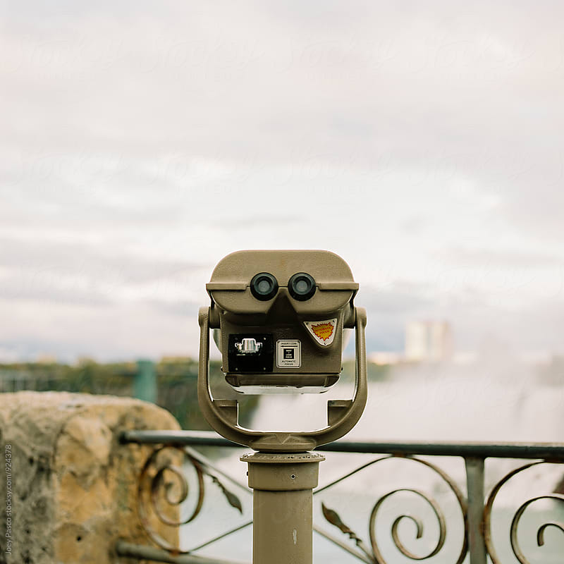 Binoculars overlooking Niagara Falls  by Joey Pasco for Stocksy United