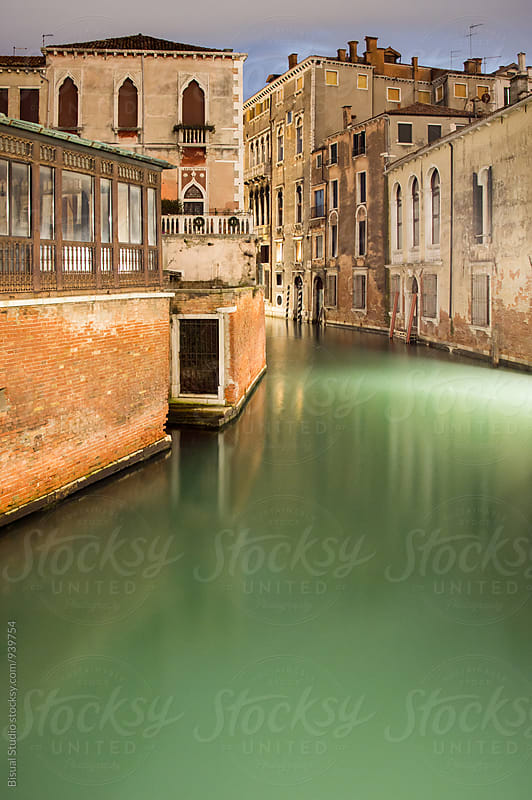 A canal in Venice at night by Bisual Studio for Stocksy United