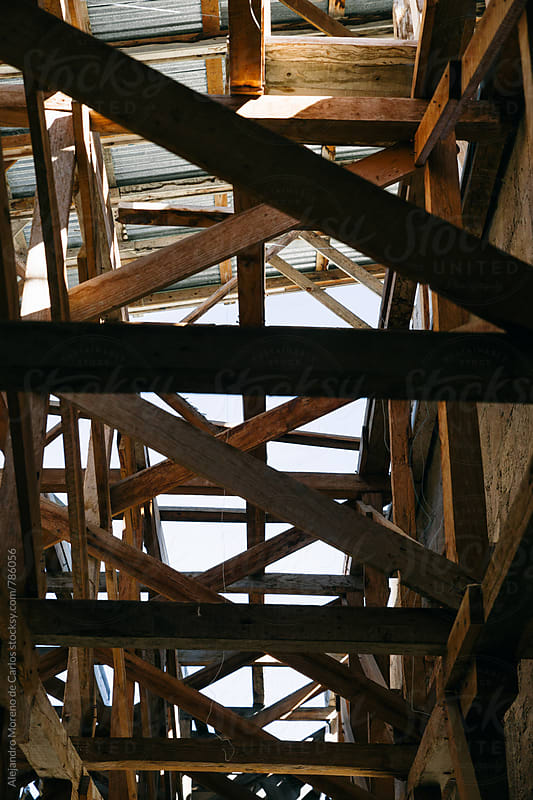 A structure of wooden scaffolding on a sunny day  by Alejandro Moreno de Carlos for Stocksy United