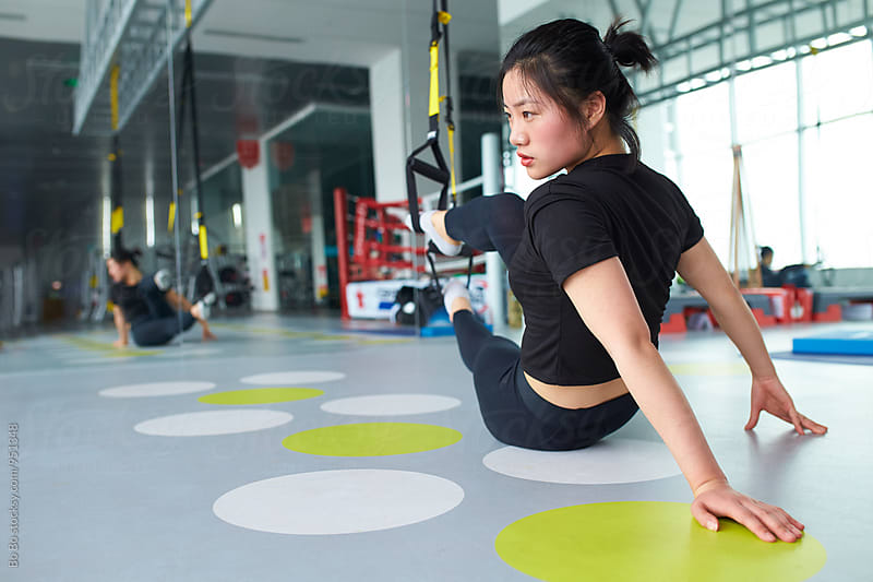 young asian woman in gym by cuiyan Liu for Stocksy United