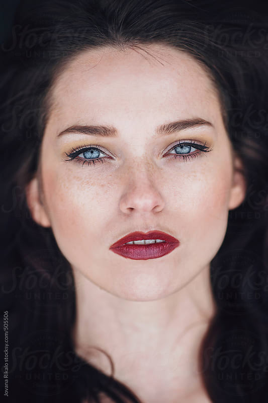 Portrait of a beautiful young woman with freckles and blue eyes by Jovana Rikalo for Stocksy United