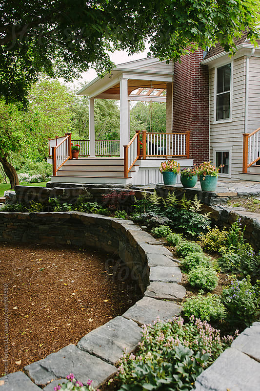 Deck and Gardens at New England Home by Raymond Forbes LLC for Stocksy United