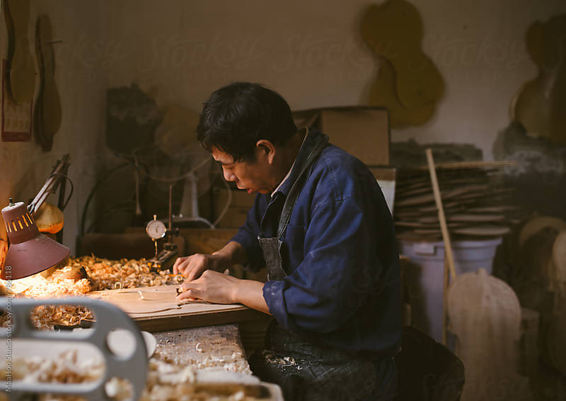Violin maker at work by MaaHoo Studio for Stocksy United