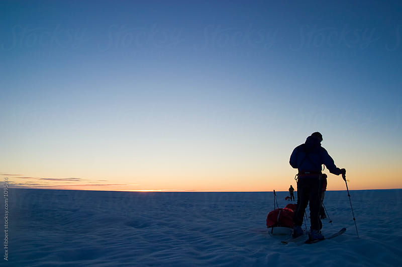 Scene of expedition life on a polar journey in Greenland by Alex Hibbert for Stocksy United
