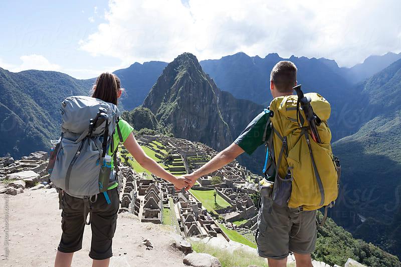 Couple trekking at Machu Picchu. Cusco. Peru. by Hugh Sitton for Stocksy United