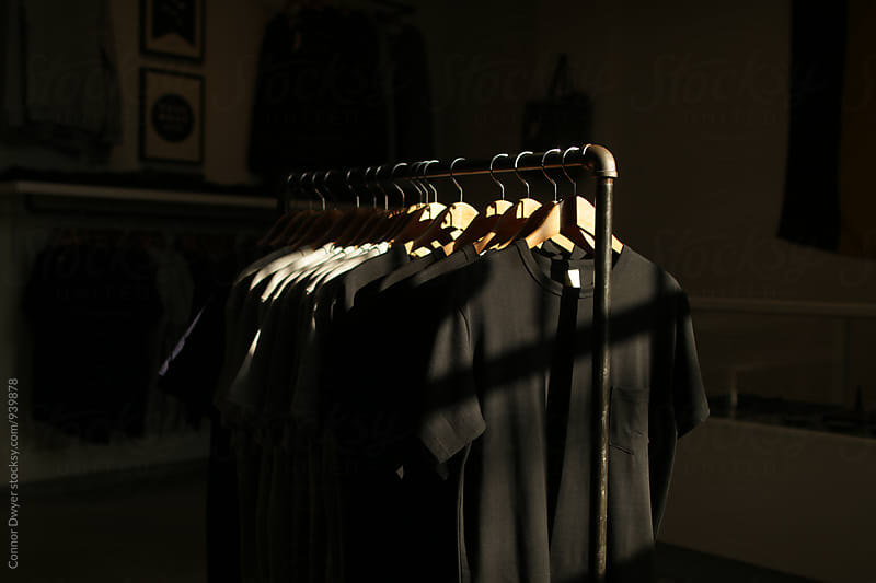 Shirts on the rack by Connor Dwyer for Stocksy United
