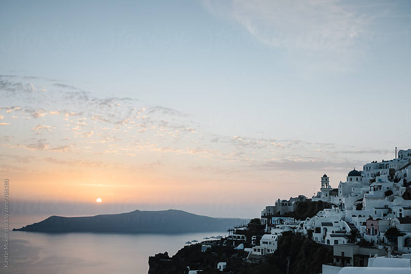 Sunset over Santorini, taken at Thira by Kirstin Mckee for Stocksy United