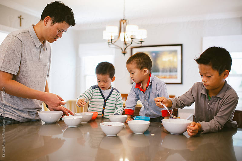 Little boys eating breakfast at home by Kristin Rogers Photography for Stocksy United