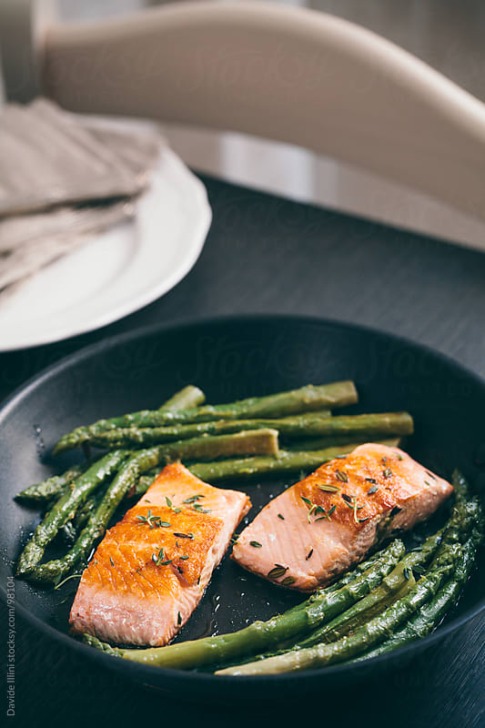 Grilled salmon with asparagus by Davide Illini for Stocksy United