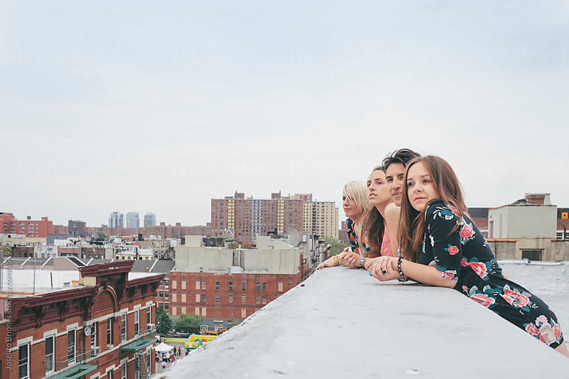 Friends Watching the City of New York from a Rooftop by Joselito Briones for Stocksy United
