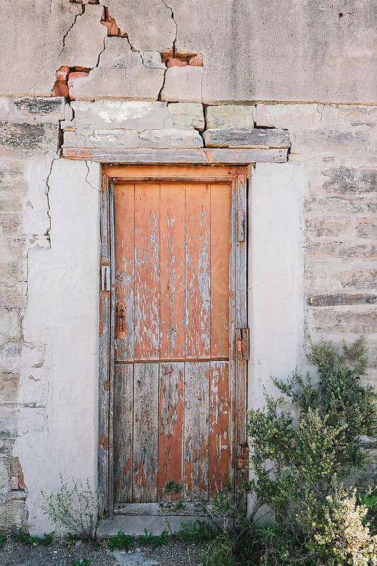 old door on derelict building by Gillian Vann for Stocksy United