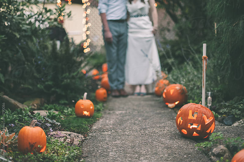 Wedding Couple's Feet with Jack-O-Lantern Decorations by Briana Morrison for Stocksy United