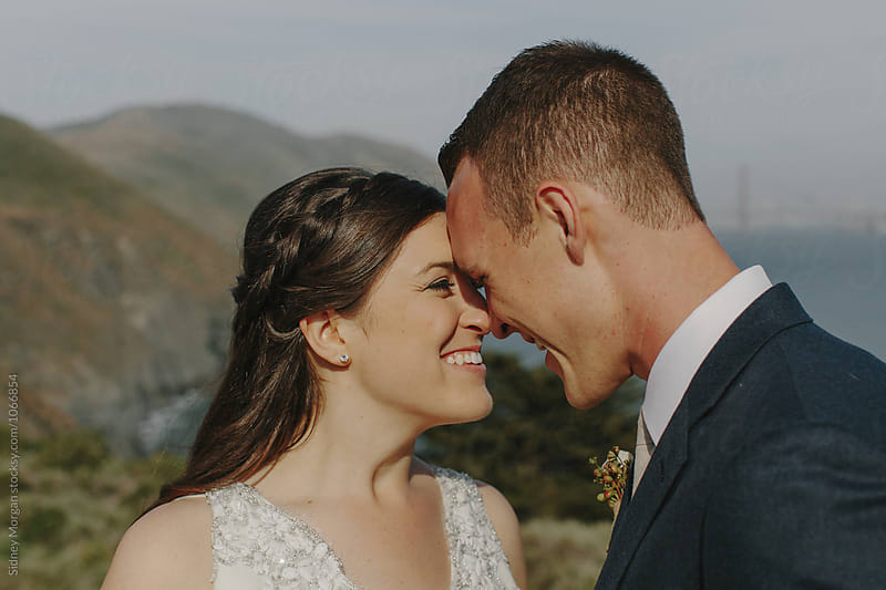 Bride Laughing at Groom by Sidney Morgan for Stocksy United