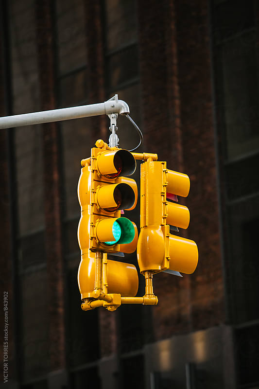 Yellow Hanged Traffic Light in New York by VICTOR TORRES for Stocksy United