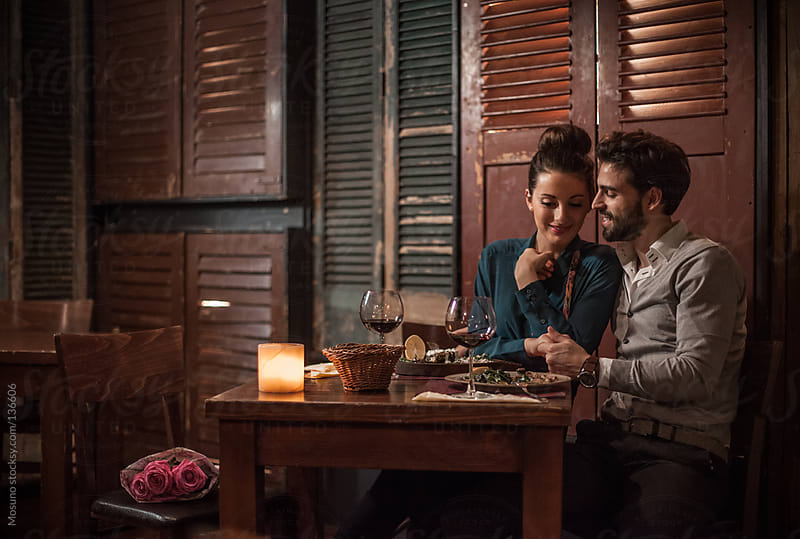 Couple Enjoying Dinner on a Valentine's Day by Mosuno for Stocksy United