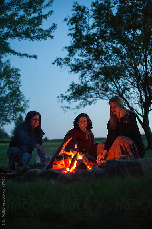Camping Lifestyle: Women Roast Marshmallows Over Campfire by Brian McEntire for Stocksy United