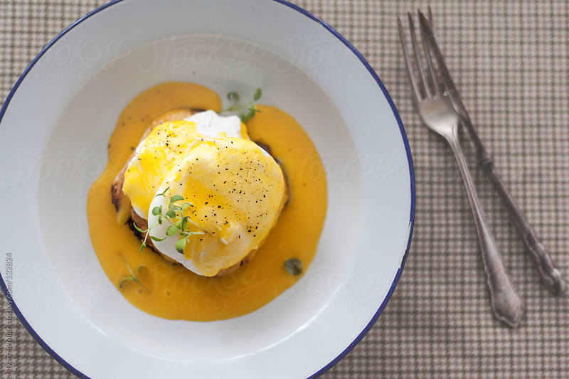 Poached eggs and muffins. by Darren Muir for Stocksy United