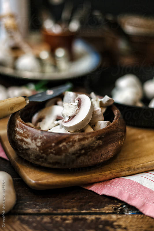 Prepping mushrooms for a recipe. by Darren Muir for Stocksy United
