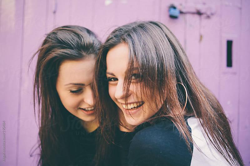 Twin teenage girls having fun. by kkgas for Stocksy United