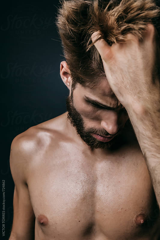 Muscular Shirtless Man in Dark Background by VICTOR TORRES for Stocksy United