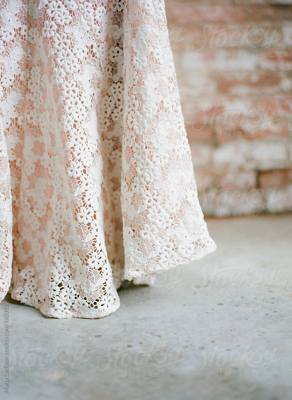 Blush and ivory lace dress detail by Marta Locklear for Stocksy United