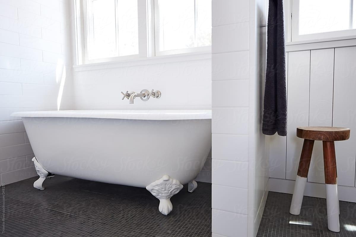 . Clawfoot bathtub in bathroom of modern design farmhouse by Trinette