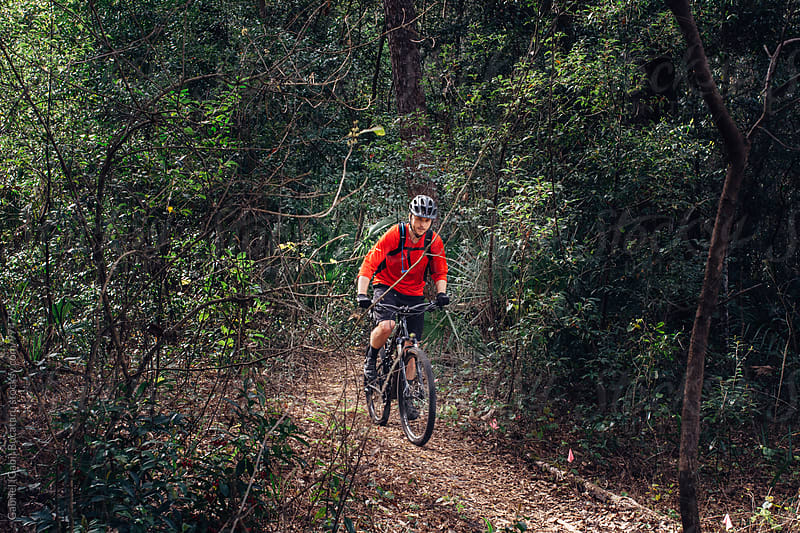 Male mountain bike rider on a trail in the forest by Gabriel (Gabi) Bucataru for Stocksy United